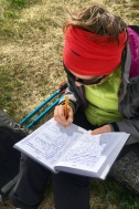 """Isable signing the """"book of fame"""" at Knivskjelodden (710 12´ 2¨)"""