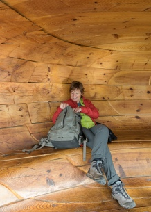 Isabel taking shelter from the wind at Snohetta View Point